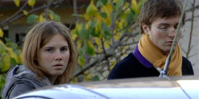 FILE - In this Nov. 2, 2007 file photo, Amanda Knox, left, and Raffaele Sollecito, are seen outside the rented house where 21-year-old British student Meredith Kercher was found dead in Perugia, Italy. The founder of a heavily visited Wiki site about the prosecutions of U.S. star defendant Amanda Knox and her former Italian boyfriend is bracing for a spike in traffic when Italy's high court decides next Wednesday, March 25, 2015 whether to confirm the guilty verdicts against the former lovers in the 2007 murder of Knox's British roommate. (AP Photo/Stefano Medici, File)