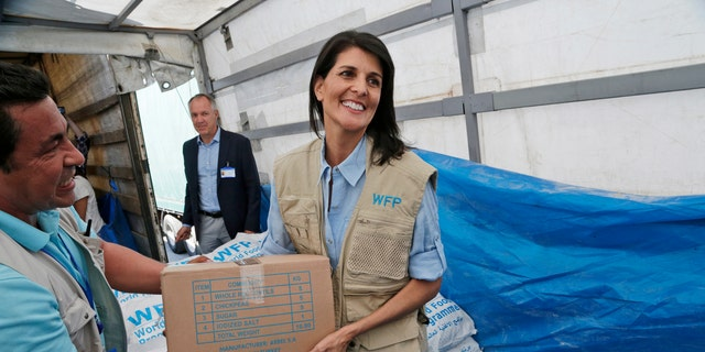 In this May 24 photo, U.S. Ambassador to the U.N. Nikki Haley holds a food parcel provided by the World Food Programme during a visit at the Reyhanli border crossing with Syria, near Hatay, southern Turkey.