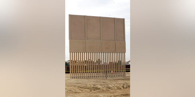 A border wall prototype stands near the border with Tijuana, Mexico, Thursday, Oct. 19, 2017, in San Diego. Companies are nearing an Oct. 26 deadline to finish building eight prototypes of President Donald Trump's proposed border wall with Mexico. (AP Photo/Gregory Bull)