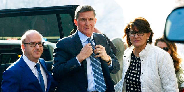 Former National Security Adviser Michael Flynn, at center, pleaded guilty to making false statements to the FBI as part of Special Counsel Robert Mueller's investigation.