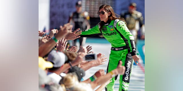 Danica Patrick greets fans as she is introduced before the NASCAR Daytona 500 Cup series auto race at Daytona International Speedway in Daytona Beach, Fla., Sunday, Feb. 18, 2018.
