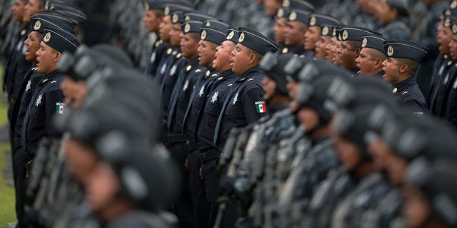 Officers belonging to Mexico's newest police force, known as the gendarmerie, take the service vow during the launching ceremony for the new force at the Federal Police headquarters in Mexico City.