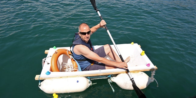 Iain Bevan, 51, a plumber from Devon in southwest England, spent two-and-a-half hours rowing across Tor Bay in an effort to raise more than $13,000.