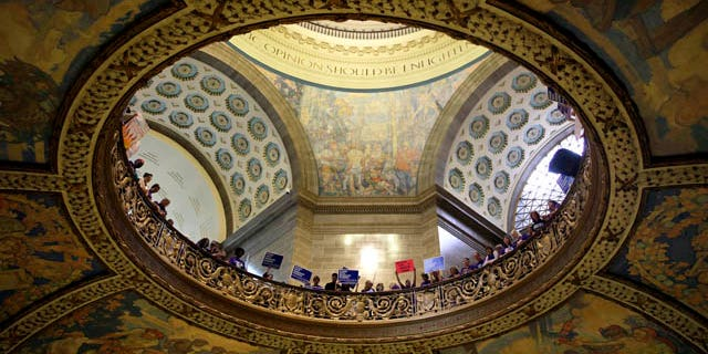 September 10, 2014: Abortion rights activists hold signs inside the Missouri Capitol in Jefferson City, Mo. (AP Photo/Jeff Roberson)