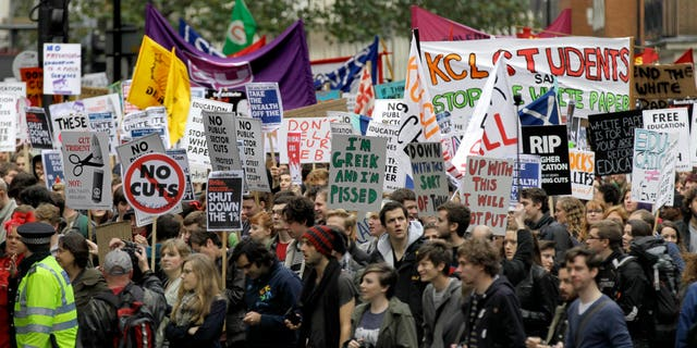 Nov. 9, 2011: Students and campaigners march through the streets of London to protest against higher tuition fees and government cuts.