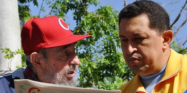 June 28: In this photo released by the state media Cubadebate web site, Cuba's Fidel Castro, left, and Venezuela's President Hugo Chavez look at Granma state newspaper at an unknown location in Havana, Cuba.