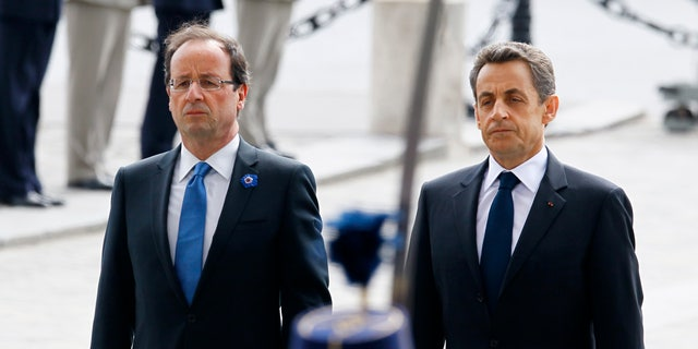 May 8, 2012: Outgoing French President Nicolas Sarkozy, right, and President-elect Francois Hollande observe a minute of silence at the Tomb of the Unknown Soldier during commemorations at the Arc de Triomphe in Paris, marking the anniversary of the end of World War II in Europe.