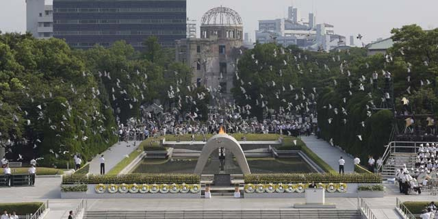 August 6, 2013: Doves fly over the cenotaph dedicated to the victims of the atomic bombing at the Hiroshima Peace Memorial Park during the ceremony to mark the 68th anniversary of the bombing, in Hiroshima, western Japan. (AP Photo)