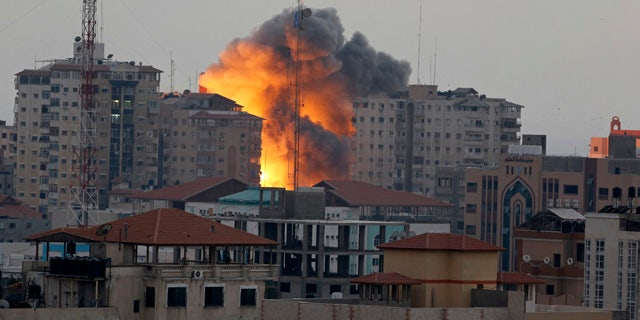 A ball of fire rises from an explosion on al-Zafer apartment tower following an Israeli air strike in Gaza City, in the northern Gaza Strip during last summer's clash. (AP)