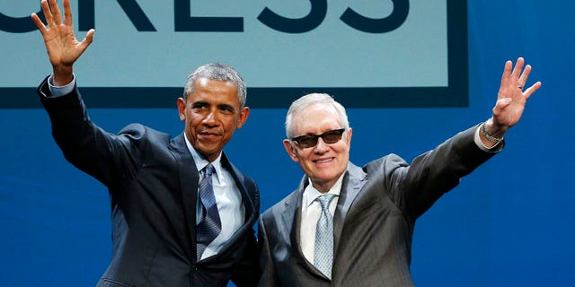 Aug. 24, 2015: President Barack Obama, left, and Senate Minority Leader Sen. Harry Reid wave onstage at the National Clean Energy Summit in Las Vegas. (AP Photo/John Locher)