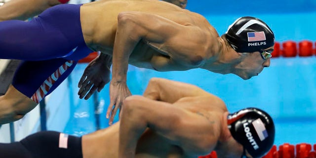 United States' Michael Phelps, top, and United States' Ryan Lochte compete in a semifinal of the men's 200-meter individual medley during the swimming competitions at the 2016 Summer Olympics, Wednesday, Aug. 10, 2016, in Rio de Janeiro, Brazil. (AP Photo/Matt Slocum)
