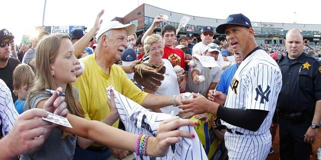 August 3, 2013: New York Yankees third baseman Alex Rodriguez signs autographs before a Class AA baseball game with the Trenton Thunder against the Reading Phillies in Trenton, N.J. (AP Photo)