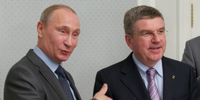 Oct. 28, 2013 - Russian President Vladimir Putin, left, and International Olympic Committee President Thomas Bach meet at the Bocharov Ruchei residence at the Black Sea resort of Sochi, southern Russia. On his 1st trip to Sochi since being elected IOC head last month, Bach met with Putin to inspect the host city.