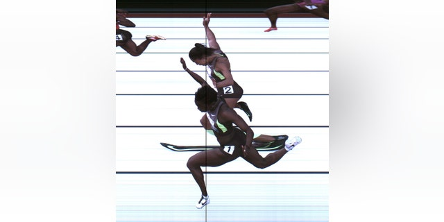 June 23, 2012: This photo provided by USA Track & Field shows the third-place finish of the women's 100-meter final from a photo-finish camera, shot at 3,000-frames-per-second, during the U.S. Olympic Track and Field Trials in Eugene, Ore.