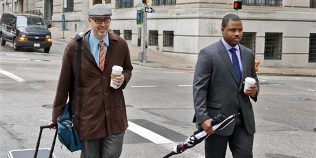 Officer William Porter, right, walking to the courthouse.