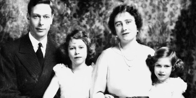 Prince George VI and Queen Mother Elizabeth with their children Princess Elizabeth, bottom right, and Princess Margaret.