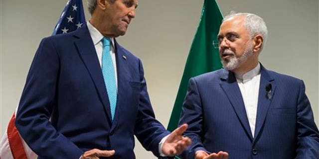 In this September file photo, Secretary of State John Kerry, left, meets with Iranian Foreign Minister Mohammad Javad Zarif at United Nations headquarters. (AP Photo/Craig Ruttle)