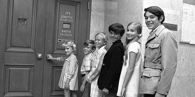 "Six youngsters who only recently met line up outside a Los Angeles, Ca. courtroom June 18, 1969 to await approval of contracts calling for them to play brothers and sisters on a new television series. The series, called ""The Brady Bunch,"" is about a widower with three boys who marries a widow with three girls and will premiere on ABC-TV in September. Left to right: Susan Olsen, 8; Michael Lookinland, 8 1/2; Eve Plumb, 11; Christopher Knight, 11; Maureen McCormick, 12; Barry Williams, 14."