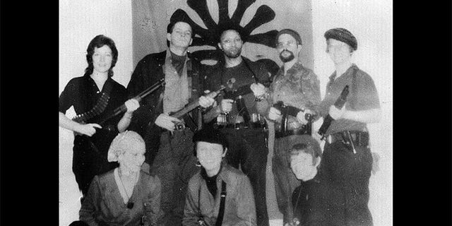 Symbionese Liberation Army members: Patty Hearst (lower left), Cinque (center rear), Camilla Hall (right rear), William Wolfe (second from left rear) and William Harris (second from right rear).