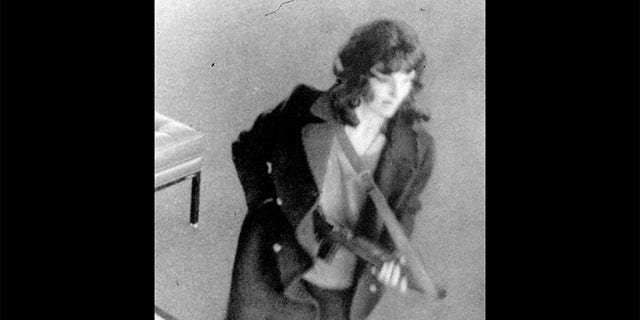 "Patty Hearst as ""Tania"" holds machine gun during the bank robbery in San Francisco."