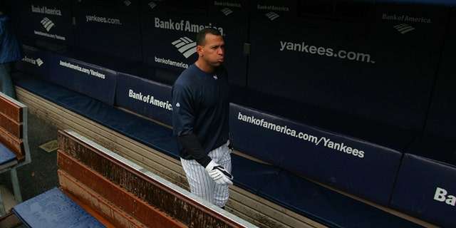 NEW YORK - OCTOBER 15:  Alex Rodriguez #13 of the New York Yankees walks through the dugout during workouts  on October 15, 2009 at Yankee Stadium in the Bronx borough of New York City.  (Photo by Jared Wickerham/Getty Images)