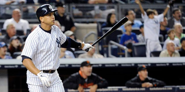Sept. 20: Alex Rodriguez watches his grand slam during the seventh inning of an interleague baseball game against San Francisco.