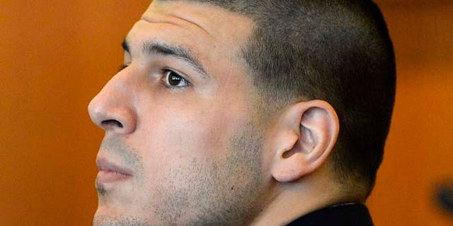 July 22, 2014: In this file photo, former New England Patriots' Aaron Hernandez watches during a hearing in Bristol County Superior Court in Fall River, Mass. (AP)