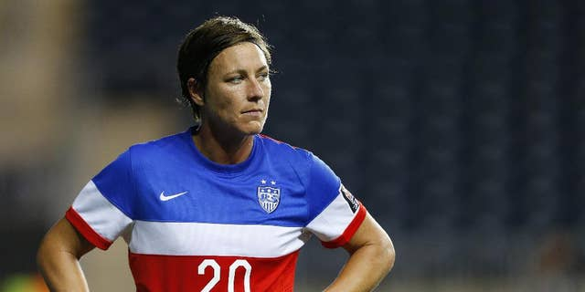 FILE - In this Oct. 26, 2014 file photo, United States forward Abby Wambach (20) stands on the field against Costa Rica during the CONCACAF championship soccer match in Chester, Pa.  The prolific goal-scorer for the U.S. women's national team will turn 35 just before the World Cup opens in June, 2015. Wambach has often said she considers this her last chance to raise the coveted trophy. (AP Photo/Rich Schultz, File)