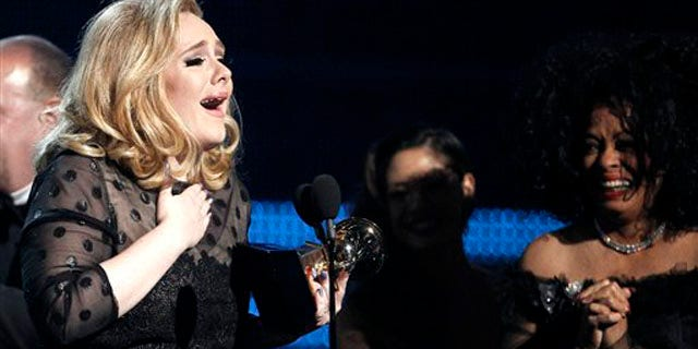 """Feb. 12, 2012: Adele accepts the award for record of the year for """"Rolling in the Deep"""" during the 54th annual Grammy Awards."""