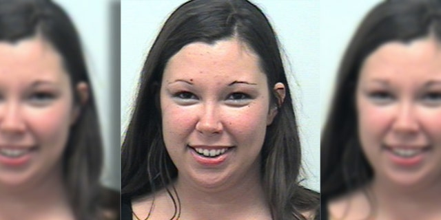 Adriane Moss allegedly locked herself and her son in a hot car for more than an hour, police said.