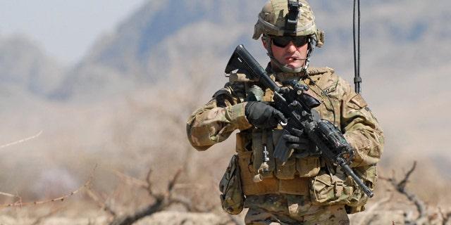 March 8, 2011: Army 1st Sgt. Raymond Dakos patrols near Combat Outpost Kowall in Kandahar, Afghanistan