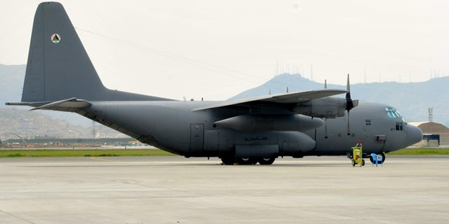 An Afghan Air Force C-130 sits on the flightline at Kabule Air Wing, Kabul International Airport, Kabul Afghanistan. The cargo plane is one of four that were provided to the Afghan Air Force with U.S. tax dollars.