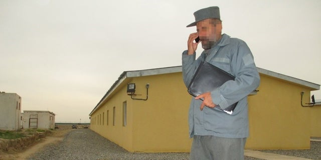 This Afghan army official was stuck with the keys to a new police barracks when the police commander refused to take them because of shoddy construction.