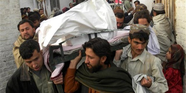 Jan. 7, 2011: People carry a dead body of Pakistani national killed in a suicide attack in neighboring Spin Boldak, Afghanistan, at a local hospital in Pakistani border town of Chaman. A suicide bomber struck a bath house in a southern Afghan border town as men gathered to wash before Friday prayers, killing a number of people, a provincial official said. The Taliban claimed responsibility, saying they targeted the deputy of an influential border patrol commander.