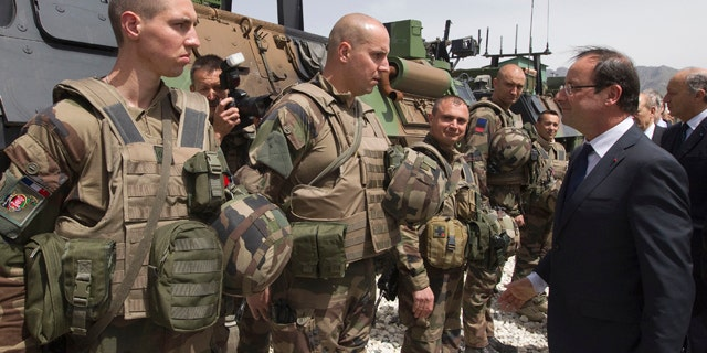 May 25, 2012: French President Francois Hollande review troops at Forward Operating Base (FOB) in Nijrab, Kapisa region, Afghanistan, where most of French troops are stationed in Afghanistan.