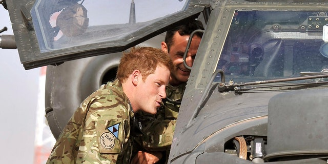 July 9, 2012 - FILE Photo of Britain's  Prince Harry examining the cockpit of an Apache helicopter at Camp Bastion in Afghanistan.