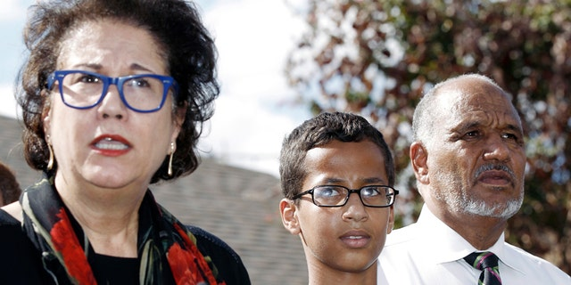 Ahmed Mohamed, 14, center, and his father Mohamed Elhassan Mohamed, right, look on as their attorney Linda Moreno, left, delivers a statement about the arrest of Ahmed during a news conference,Sept. 16, 2015, in Irving, Texas.