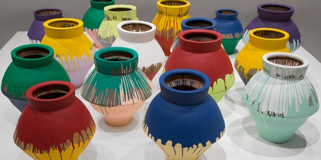 In this undated photo made available by the Brooklyn Museum of Art, shows a series of 16 vases that are part of an installation by Chinese artist Wei Wei and currently on display at the Perez Art Museum in Miami. Artist Maximo Caminero broke one of the vases on Sunday, Feb. 16, 2014.