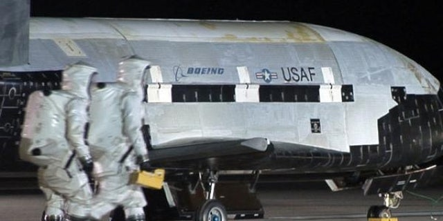 An Air Force X-37B robotic space plane is shown after it landed at Vandenberg Air Force Base in California. The fourth mission of the program is now underway and just passed 600 days in Earth orbit.