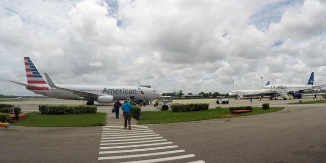 In this Friday, June 10, 2016, photo, American Airlines and JetBlue Airways charter flights wait to depart from Havana's Jose Marti International Airport. The Department of Transportation said Friday that six airlines: American, Frontier, JetBlue, Silver Airways, Southwest and Sun Country, have been selected for routes to nine Cuban cities other than Havana. (AP Photo/Scott Mayerowitz)