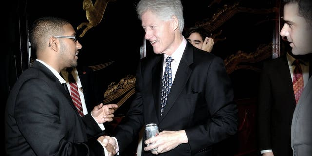 In an undated photograph, Vikrum Aiyer (left) speaks with President Bill Clinton.