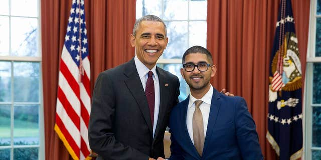 In an undated photo, Vikrum Aiyer, then chief of staff of the U.S. Patent and Trademark Office, poses with President Barack Obama.