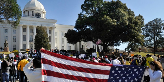 Rally against House Bill 56 at the Alabama Capitol and Children's March to the Governor's Mansion on Saturday, Dec. 17, 2011, in Montgomery, Ala.. (AP Photo/Montgomery Advertiser, Lloyd Gallman) NO SALES