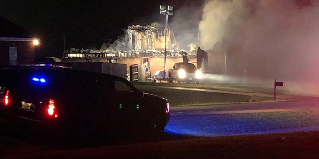 A man shot and killed his wife in addition and one of his four children before setting their home in Alabama on fire and killing himself on Saturday, officials said.