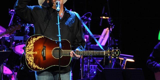 November 22, 2013. Alan Jackson performs at the George Jones Tribute - Playin' Possum: The Final No Show at the Bridgestone Arena in Nashville, Tenn.