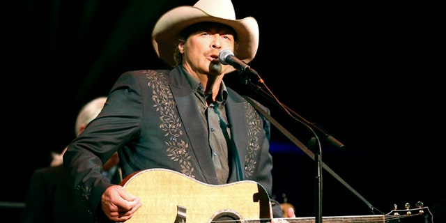 "Singer Alan Jackson performs during ""A Concert for Hope"" at the Kennedy Center in Washington September 11, 2011 on the 10th anniversary of the 9/11 attacks."