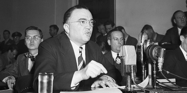 """This March 26, 1947, file photo shows Federal Bureau of Investigation Director J. Edgar Hoover calling the communist party of the United States a """"Fifth Column"""" whose """"goal is the overthrow of our government"""" during testimony before the House Un-American Activities Committee in Washington. (AP)"""