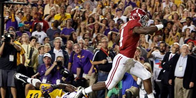 Nov. 3, 2012: Alabama running back T.J. Yeldon (4) runs over LSU defensive end Barkevious Mingo (49) for the go ahead touchdown to beat LSU 21-17 during the second half of an NCAA college football game.