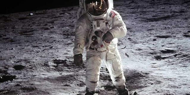 "Buzz Aldrin, Apollo 11, 1969: Astronaut Buzz Aldrin, lunar module pilot, walks on the surface of the Moon near the leg of the Lunar Module ""Eagle"" during the Apollo 11 extravehicular activity."