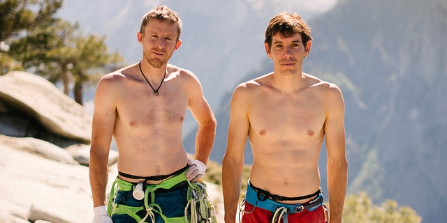 Alex Honnold, right, and Tommy Caldwell pose for a portrait at the top of El Capitan in Yosemite National Park, Calif. (Corey Rich/Reel Rock /Novus Select via AP)